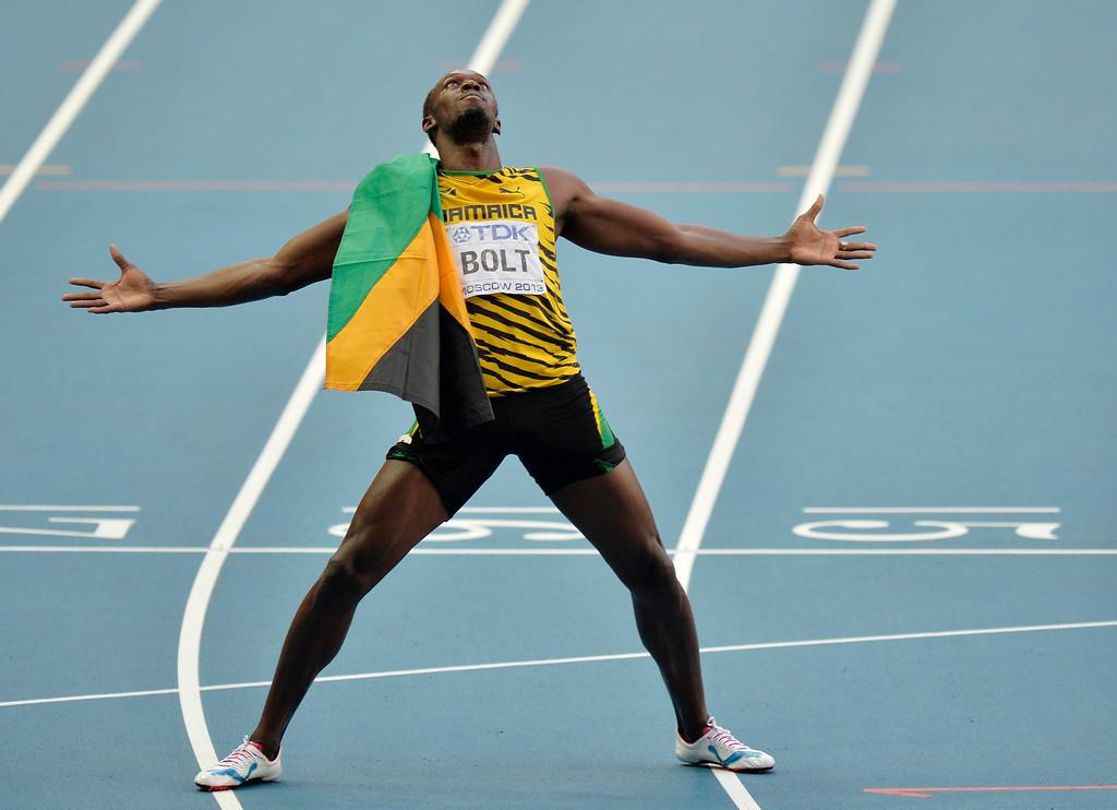. Jamaica\'s Usain Bolt celebrates winning gold in the men\'s 200-meter final at the World Athletics Championships in the Luzhniki stadium in Moscow, Russia, Saturday, Aug. 17, 2013. (AP Photo/Martin Meissner)