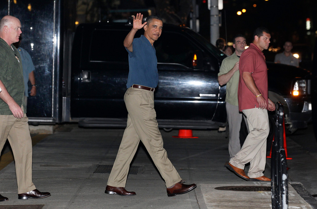 . In this Dec. 29, 2010 file photo, President Barack Obama waves as he leaves Alan Wong\'s Restaurant in Honolulu, Hawaii, after dining with family and friends. (AP Photo/Carolyn Kaster, File)
