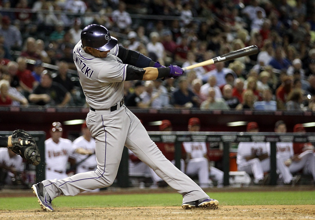 . Troy Tulowitzki #2 of the Colorado Rockies hits a two run home-run against the Arizona Diamondbacks during the sixth inning of the MLB game at Chase Field on April 29, 2014 in Phoenix, Arizona.  (Photo by Christian Petersen/Getty Images)
