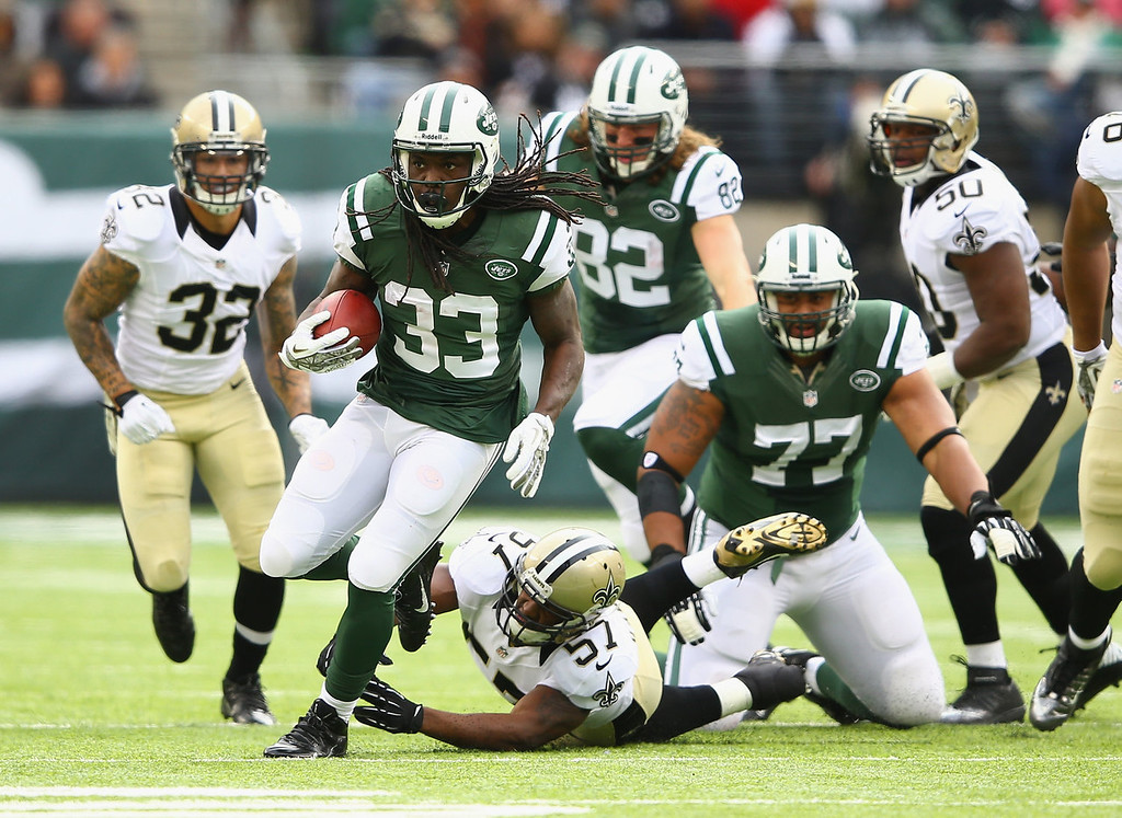 . Chris Ivory #33 of the New York Jets eludes the tackle of  David Hawthorne #57 of the New Orleans Saints during their game at MetLife Stadium on November 3, 2013 in East Rutherford, New Jersey.  (Photo by Al Bello/Getty Images)