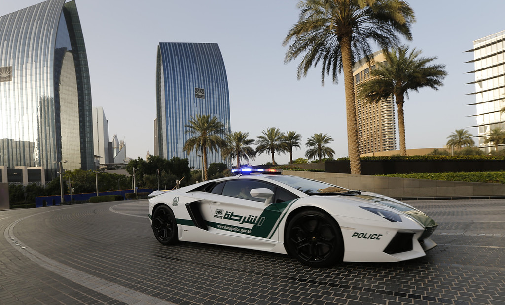 . Emirati policemen patrol in an especially modified Lamborghini Aventador on April 16, 2013 in the Gulf emirate of Dubai. The introduction of the sports car, which can reach speeds of up to 349 km/h (217 mph), aims to make justice quicker on Dubai\'s dangerous highways. KARIM SAHIB/AFP/Getty Images