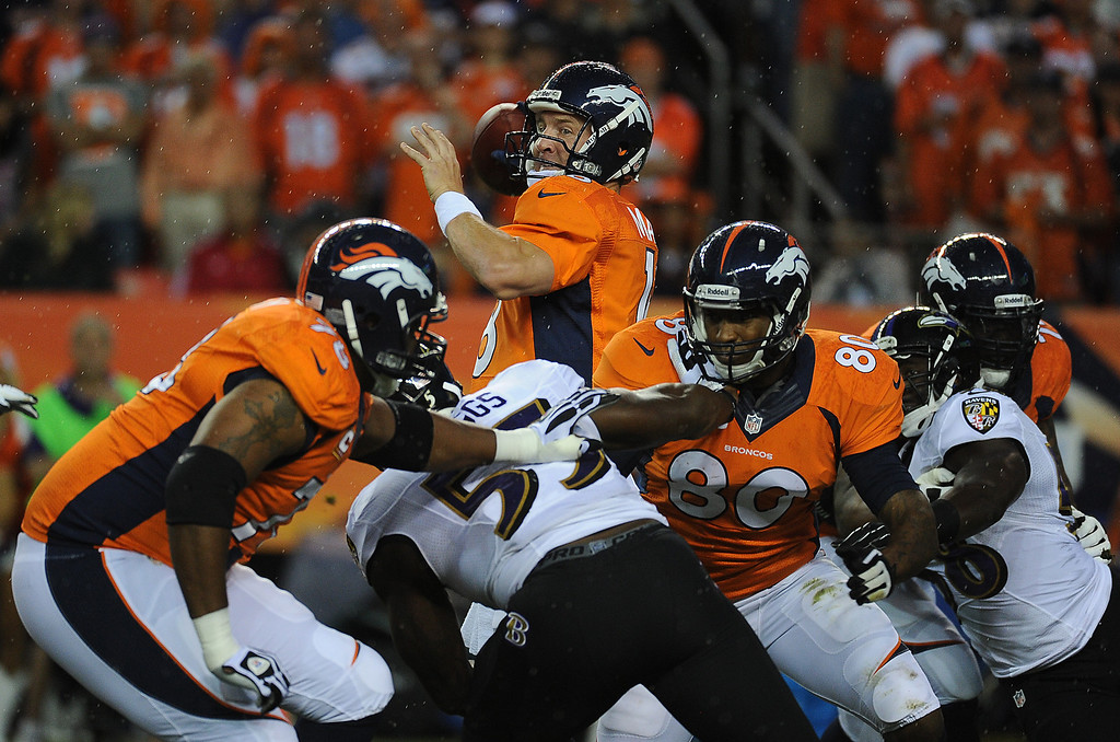 . DENVER, CO - SEPTEMBER 05: Denver Broncos quarterback Peyton Manning (18) drops back to pass in the first quarter. The Denver Broncos took on the Baltimore Ravens in the first game of the 2013 season at Sports Authority Field at Mile High in Denver on September 5, 2013. (Photo by Tim Rasmussen/The Denver Post)