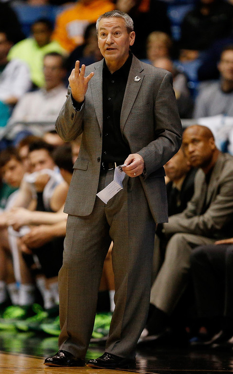 . Head coach Joe Callero of the Cal Poly Mustangs motions to his players during the first round of the 2014 NCAA Men\'s Basketball Tournament against the Texas Southern Tigers at UD Arena on March 19, 2014 in Dayton, Ohio.  (Photo by Gregory Shamus/Getty Images)