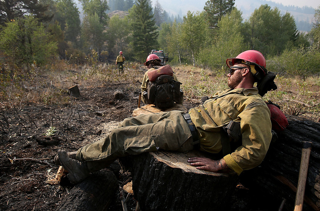. Billy, who declined to give his last name, of the Tatanka Hotshots of South Dakota, takes a quick cat nap after working on the line for the past four days at the 111,000 acre Elk Fire Complex near Pine, Idaho on Wednesday, Aug. 14, 2013. (AP Photo/Times-News, Ashley Smith)