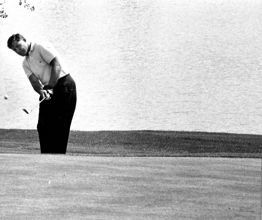 . Mike Souchak hits a chip to the 18th green at Cherry Hills Country Club in preparation for the 1960 Open at the Englewood Club. Denver Post Library photo archive