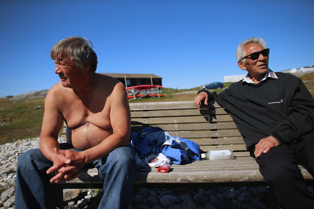 . Jens Johan Broberg (L) and Samuel Storch enjoy a warm afternoon together on July 28, 2013 in Nuuk, Greenland. (Photo by Joe Raedle/Getty Images)