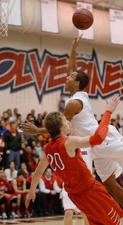 . Brighton\'s Michael Willis (20) gets the charging foul on Chaparral\'s Brandon Malone (1) during the first quarter February 27, 2013. (Photo By John Leyba/The Denver Post)