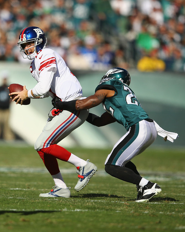 . Eli Manning #10 of the New York Giants eludes the grasp of  Brandon Boykin #22 of the Philadelphia Eagles during their game at Lincoln Financial Field on October 27, 2013 in Philadelphia, Pennsylvania.  (Photo by Al Bello/Getty Images)