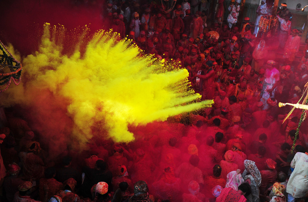 . Indian Hindu devotees throw coloured powder at the Radha Rani temple during the Lathmar Holi festival in Barsana on March 21, 2013. Lathmar Holi is a local celebration, but it takes place well before the national Holi day on March 27. Sanjay Kanojia/AFP/Getty Images