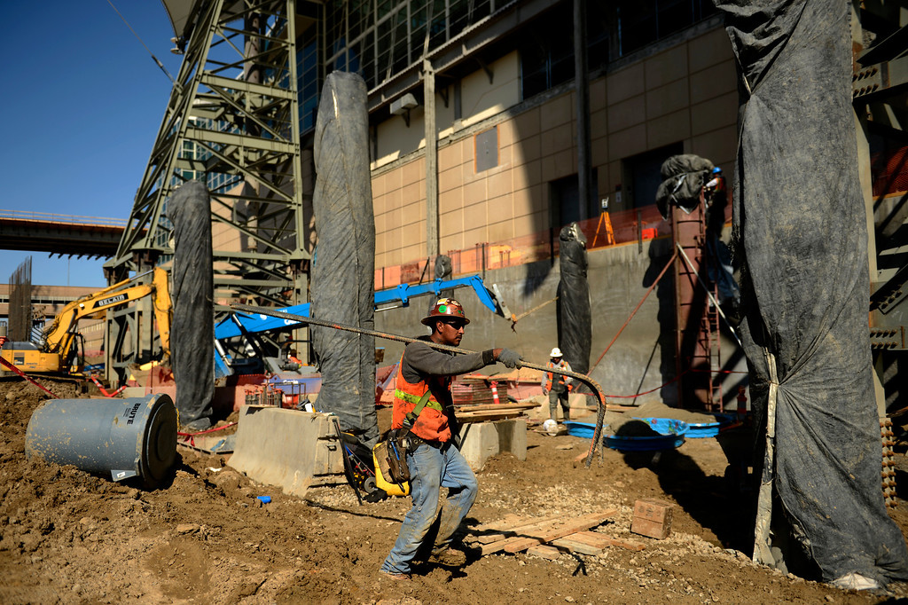 . A construction worker carrying rebar as the Denver International Airport South Terminal Redevelopment Program is now starting to build vertical. The Westin Hotel and conference center is beginning to take shape. March 27, 2013 Denver, Colorado. (Photo By Joe Amon/The Denver Post)