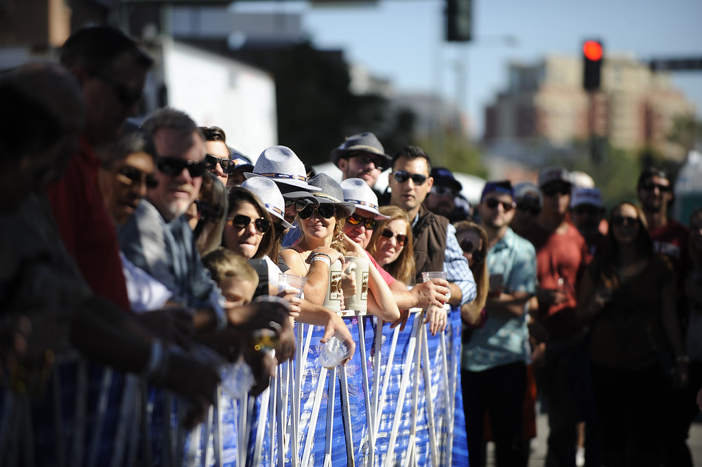 . DENVER, CO: Sept 28, 2013  Crowds gather at Denver\'s Oktoberfest and watch the keg bowling competition. Contestants rolled a keg on wheels down the street and attempted to knock down a stack of kegs.   (Photo By Erin Hull/The Denver Post)