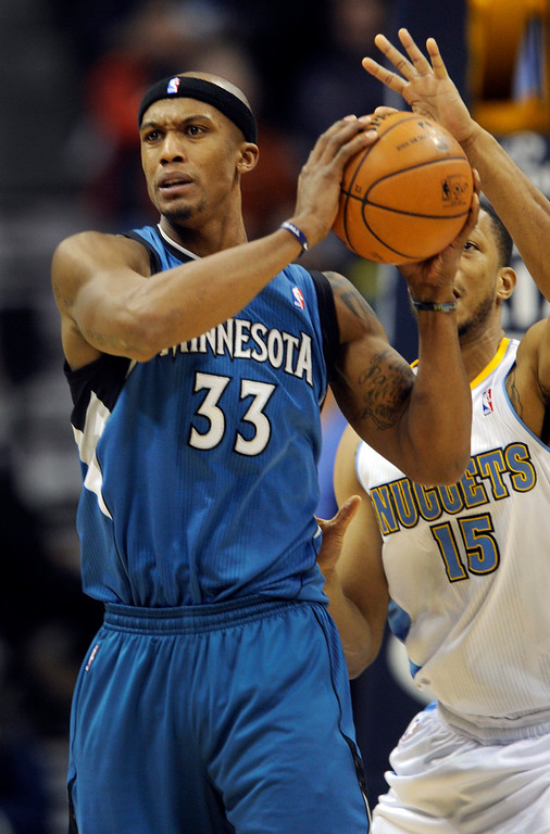 . Denver forward Anthony Randolph (15) came up from behind on Wolves forward Dante Cunningham (33) to attempt a steal in the second half. The Minnesota Timberwolves took a bite out of the Denver Nuggets winning 101-97 at the Pepsi Center Thursday night, January 3, 2013. Karl Gehring/The Denver Post