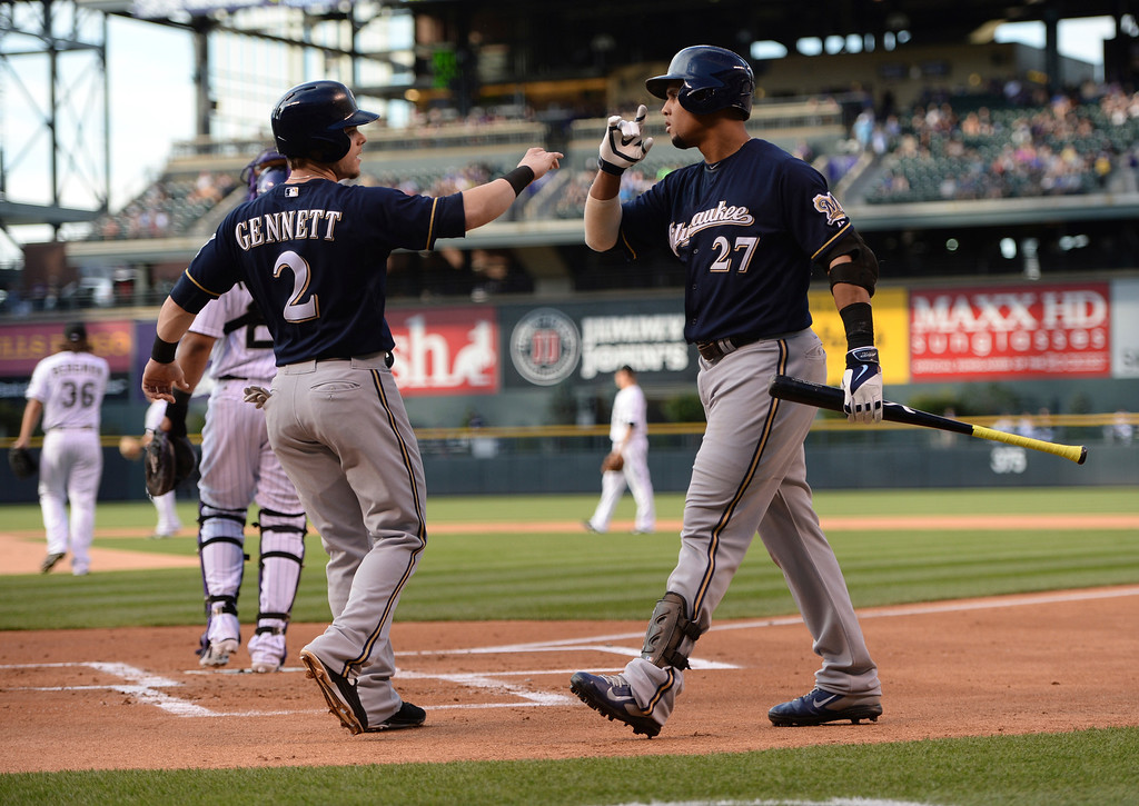 . DENVER, CO - JUNE 20: Scooter Gennett was congratulated by Carlos Gomez after Gennett scored in the first inning on a hit by Jonathan Lucroy. The Colorado Rockies hosted the Milwaukee Brewers at Coors Field Friday night, June 20, 2014. Photo by Karl Gehring/The Denver Post
