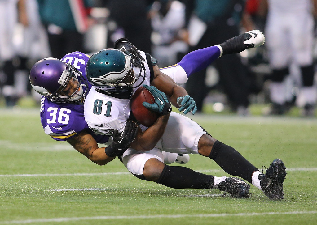 . Robert Blanton #36 of the Minnesota Vikings tackles Jason Avant #81 of the Philadelphia Eagles on December 15, 2013 at Mall of America Field at the Hubert H. Humphrey Metrodome in Minneapolis, Minnesota. (Photo by Adam Bettcher/Getty Images)