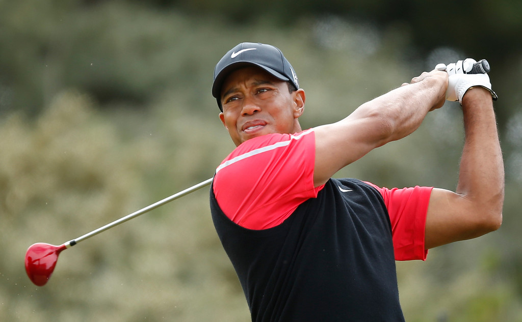 . Tiger Woods of the United States drives off the third tee during the final round of the British Open Golf Championship at Muirfield, Scotland, Sunday July 21, 2013. (AP Photo/Matt Dunham)