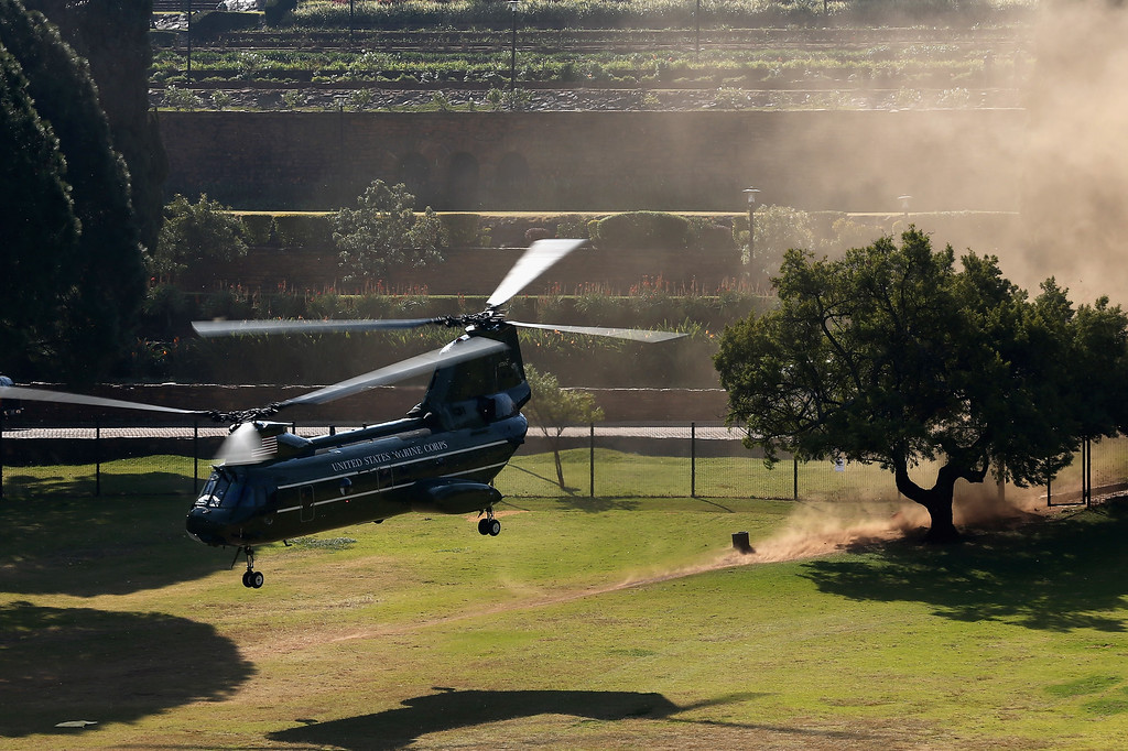 . PRETORIA, SOUTH AFRICA - JUNE 29:  Helicopters follow Marine One as US President Barack Obama and wife Michelle Obama leave the Union Buildings on June 29, 2013 in Pretoria, South Africa. This is Obama\'s first official visit to South Africa, and is holding bilateral meetings with President Jacob Zuma, and also meeting with students in Soweto Township. During his tour the president will also visit Robben Island, where former President Nelson Mandela spent some of his 27 years in prison for fighting against apartheid.  (Photo by Dan Kitwood/Getty Images)