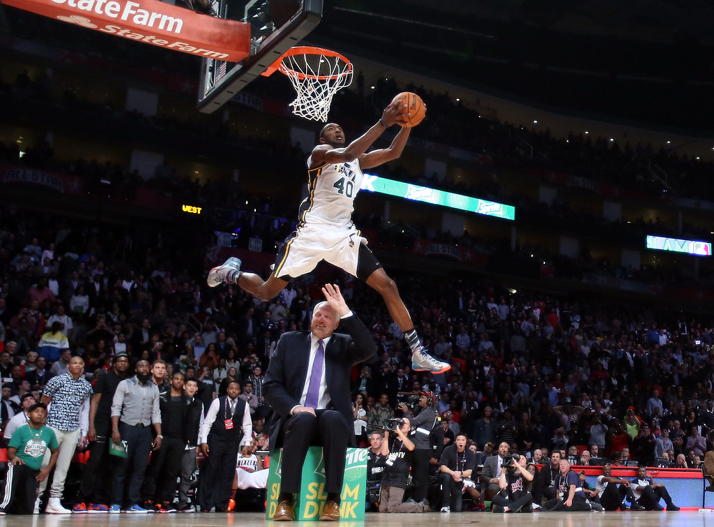 . HOUSTON, TX - FEBRUARY 16:  Jeremy Evans of the Utah Jazz dunks the ball over former Jazz player Mark Eaton in the first round during the Sprite Slam Dunk Contest part of 2013 NBA All-Star Weekend at the Toyota Center on February 16, 2013 in Houston, Texas.  (Photo by Ronald Martinez/Getty Images)