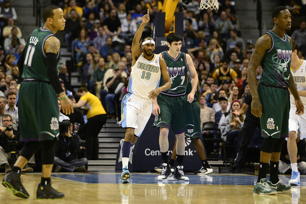 . DENVER, CO - FEBRUARY 5: Corey Brewer Denver Nuggets (13) celebrates a dunk against the Milwaukee Bucks during the first half. The Denver Nuggets take on the Milwaukee Bucks in NBA action. (Photo By AAron Ontiveroz/The Denver Post)