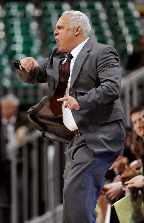 . Texas State coach Doug Davalos calls to his team during the second half of a Western Athletic Conference tournament NCAA college basketball game against Denver, Thursday, March 14, 2013, in Las Vegas. Texas State won 72-68. (AP Photo/David Becker)
