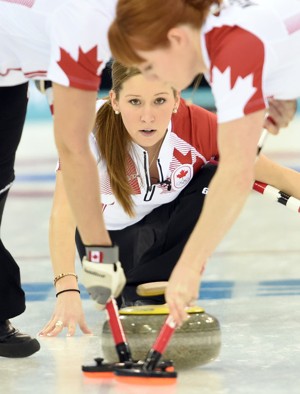 . Canada\'s Kaitlyn Lawes throws the stone during the Women\'s Curling Round Robin Session 6 against Switzerland at the Ice Cube Curling Center during the Sochi Winter Olympics on February 13, 2014. DAMIEN MEYER/AFP/Getty Images