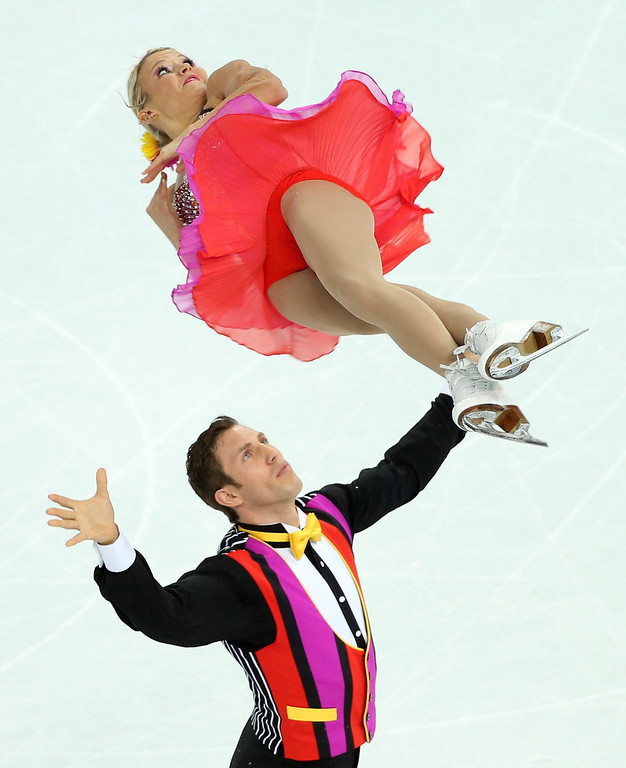 Description of . Kirsten Moore-Towers and Dylan Moscovitch of Canada perform during the Pairs Short Program of the Figure Skating event at Iceberg Palace during the Sochi 2014 Olympic Games, Sochi, Russia, 11 February 2014.  EPA/HOW HWEE YOUNG