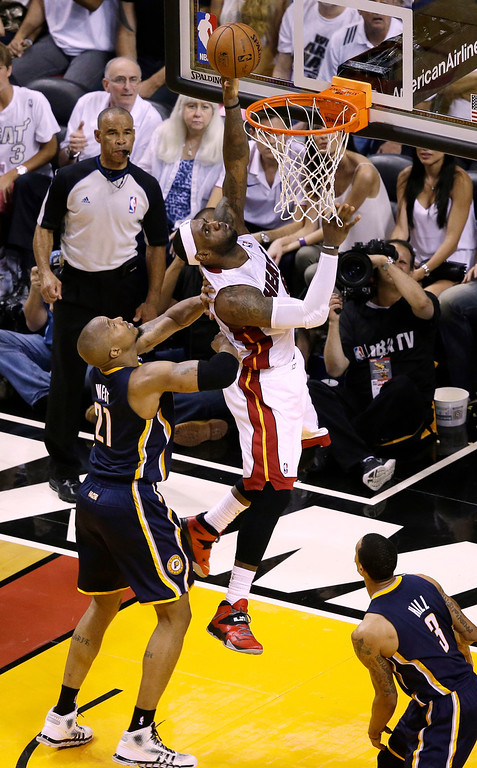 . Miami Heat forward LeBron James (6) drives to the basket over Indiana Pacers forward David West (21) during the second half of Game 4 in the NBA basketball Eastern Conference finals playoff series, Monday, May 26, 2014, in Miami. The Heat defeated the Pacers 102-90. (AP Photo/Lynne Sladky)