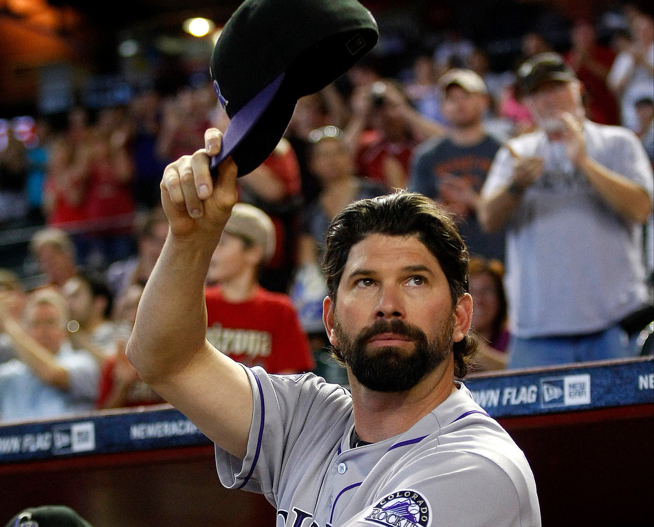 . Colorado Rockies first baseman Todd Helton acknowledges the crowd in the second inning of a baseball game against the Arizona Diamondbacks after announcing his retirement at the end of the season on Sunday, Sept. 15, 2013, in Phoenix. (AP Photo/Rick Scuteri)