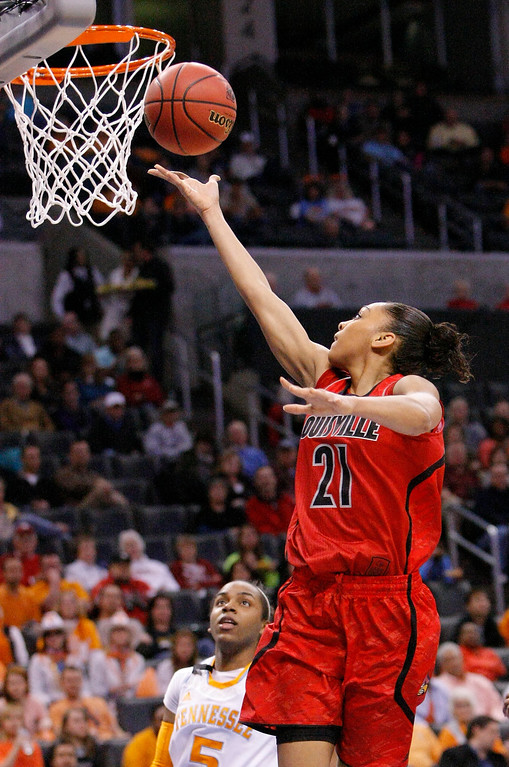 . Louisville\'s Bria Smith (21) goes to the basket against Tennessee during the first half of the Oklahoma City regional final in the NCAA women\'s college basketball tournament in Oklahoma City, Tuesday, April 2, 2013. (AP Photo/Alonzo Adams)