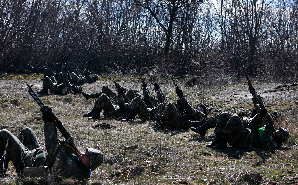 . Ukrainian border guards perform an exercise in anti-air attack during training at a military camp in the village of Alekseyevka on the Ukrainian-Russian border, eastern Ukraine, Friday, March 21, 2014.  (AP Photo/Sergei Grits)