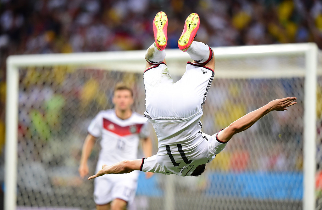 . Germany\'s forward Miroslav Klose (R) celebrates after scoring during a Group G football match between Germany and Ghana at the Castelao Stadium in Fortaleza during the 2014 FIFA World Cup on June 21, 2014. JAVIER SORIANO/AFP/Getty Images