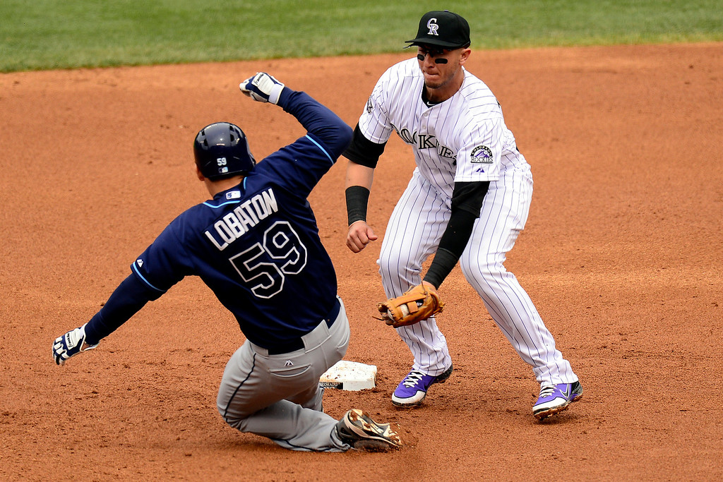 . DENVER, CO - MAY 5: Jeremy Hellickson (58) of the Tampa Bay Rays gets tagged out after being checekd by Wilin Rosario (20) during the Rockies\' 8-3 loss.   (Photo by AAron Ontiveroz/The Denver Post)