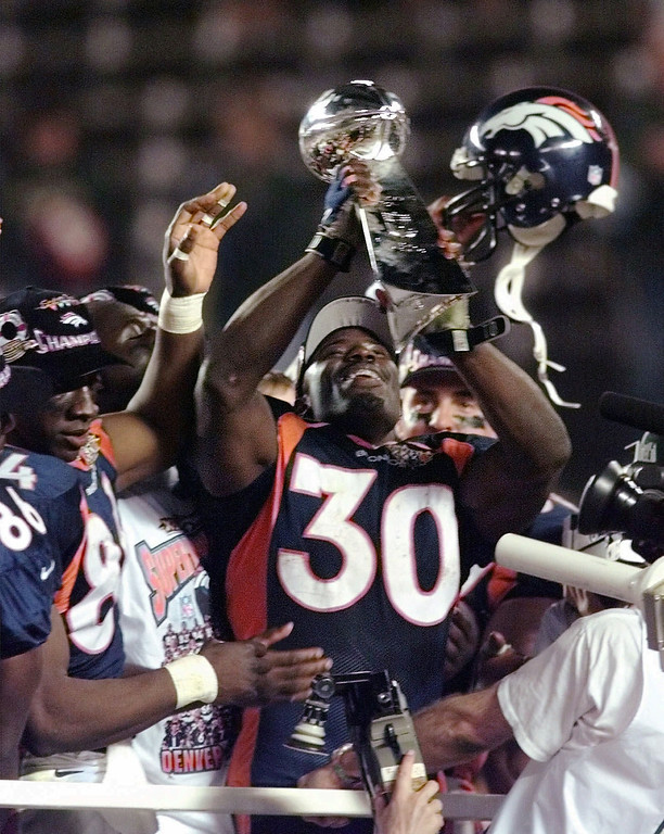 . Denver Broncos running back Terrell Davis holds the Lombardi trophy in the air after Denver beat the Green Bay Packers 31-24 in Super Bowl XXXII Sunday, Jan. 25, 1998, at San Diego\'s Qualcomm Stadium. (AP Photo/Hans Deryk)