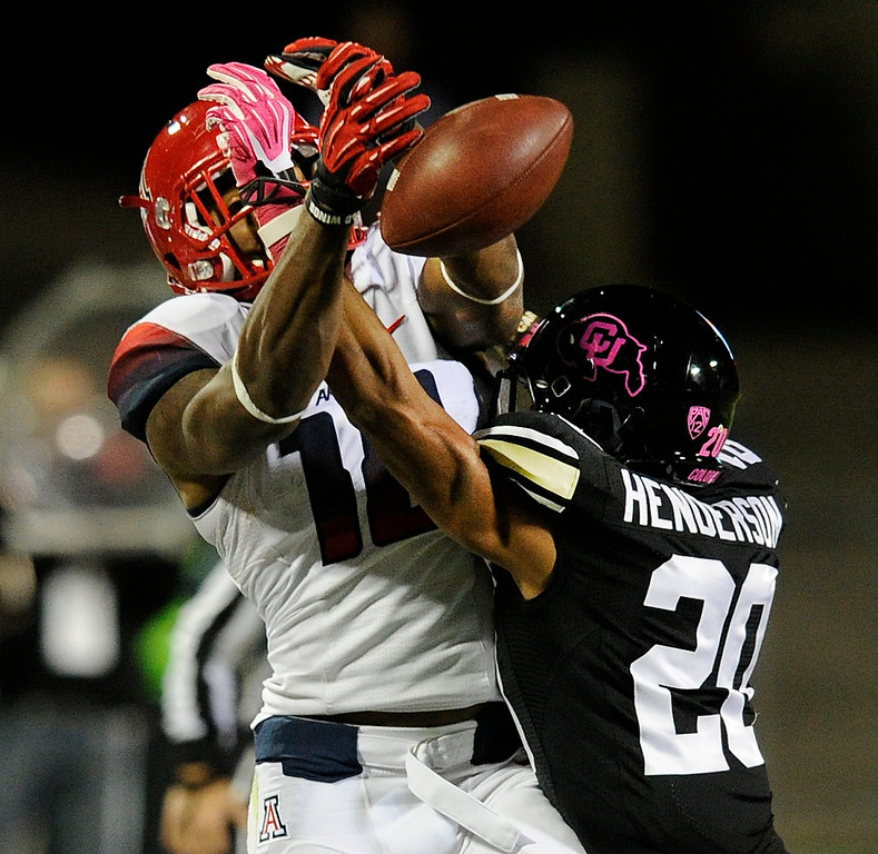 . BOULDER, CO. - OCTOBER 26: Colorado defensive back Greg Henderson (20) knocked the ball away from Arizona receiver Terrence Miller (18) in the first half. The University of Colorado football team hosted Arizona Saturday night, October 26, 2013. Photo By Karl Gehring/The Denver Post
