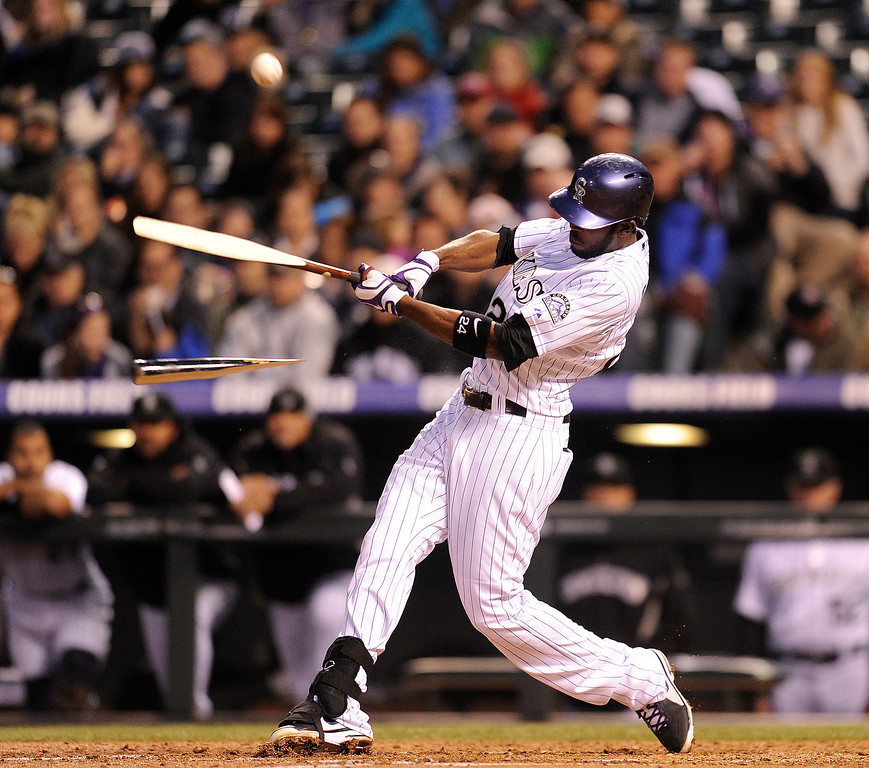 . DENVER, CO. - APRIL 19:  Colorado batter Dexter Fowler cracked his bat after connecting with a pitch in the fourth inning. The Colorado rockies hosted the Arizona Diamondbacks at Coors Field Friday night, April 19, 2013.  Photo By Karl Gehring/The Denver Post)