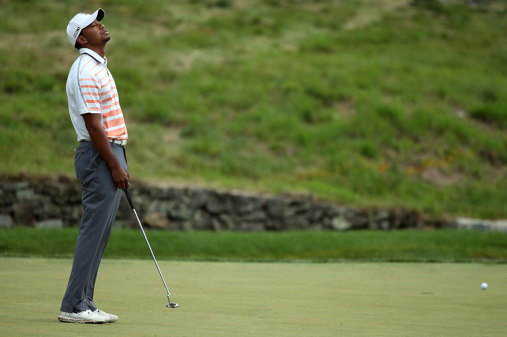 . Tiger Woods of the United States reacts on the ninth green during Round Two of the 113th U.S. Open at Merion Golf Club on June 14, 2013 in Ardmore, Pennsylvania.  (Photo by Andrew Redington/Getty Images)