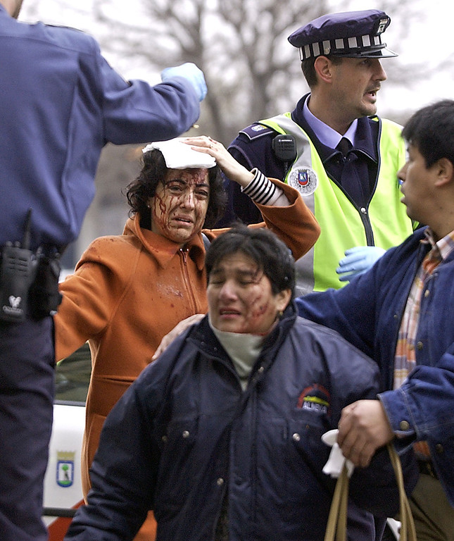 . Victims are evacuated after a train exploded at the Atocha train station in Madrid 11 March 2004. At least 198 people were killed and more than 1,400 wounded in bomb attacks on four commuter trains. RICARDO CASES/AFP/Getty Images