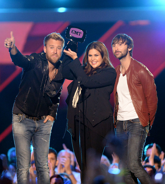 . NASHVILLE, TN - JUNE 05:  (L-R) Charles Kelley, Hillary Scott and Dave Haywood of Lady Antebellum accept award onstage during the 2013 CMT Music awards at the Bridgestone Arena on June 5, 2013 in Nashville, Tennessee.  (Photo by Jason Merritt/Getty Images)