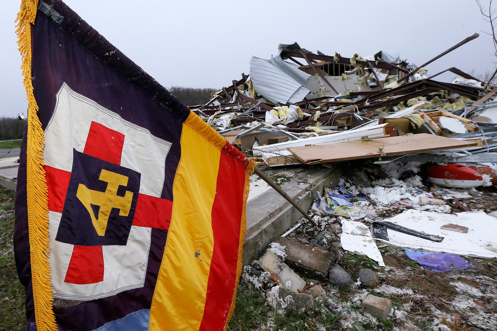 . A flag flutters over what remains of the sanctuary of the Botkinburg Foursquare Church in Botkinburg, Ark., Thursday, April 11, 2013 after a severe storm struck the building late Wednesday.  (AP Photo/Danny Johnston)