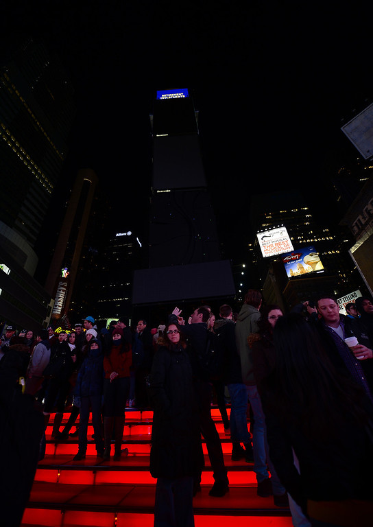 ". Large electronic billboards stand dark on Times Square as their lights were turned off too mark ""Earth Hour\"" in New York, March 23, 2013. More than 150 countries across the world, switched off their lights for an hour at 20:30 local time to support action to create a sustainable future for the planet. EMMANUEL DUNAND/AFP/Getty Images"