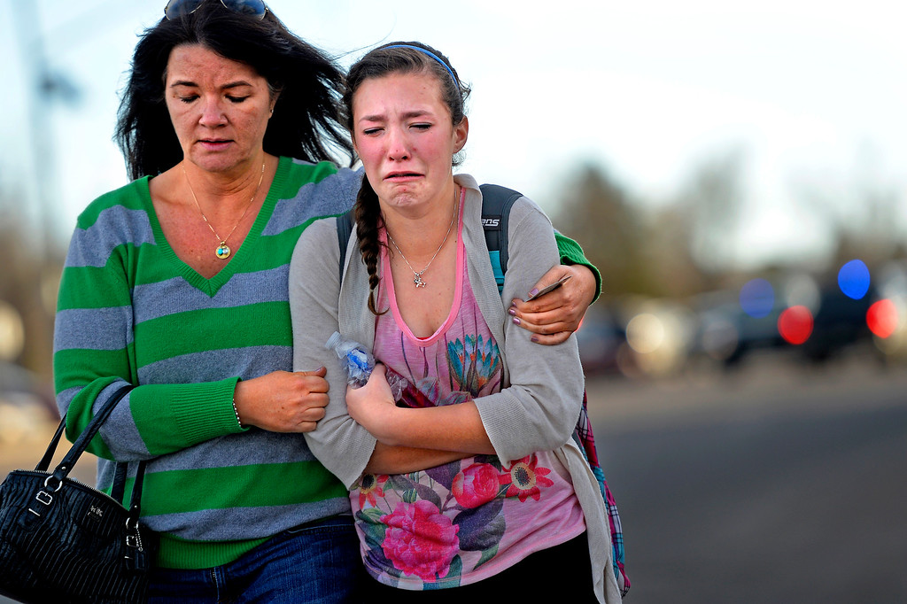 . CENTENNIAL, CO. - December 13: Leaving the  Shepherd of the Hills church during a lockdown when a student carried a shotgun into Arapahoe High School and opened fire on Friday, wounding two fellow students before apparently killing himself December 13, 2013 Centennial, CO. (Photo By Joe Amon/The Denver Post)