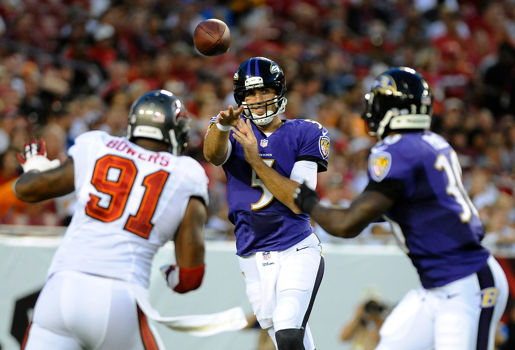 . Baltimore Ravens quarterback Joe Flacco (5) throws a pass to running back Bernard Pierce, right, as Tampa Bay Buccaneers defensive end Da\'Quan Bowers (91) moves in during the first quarter an NFL preseason football game Thursday, Aug. 8, 2013, in Tampa, Fla. (AP Photo/Brian Blanco)