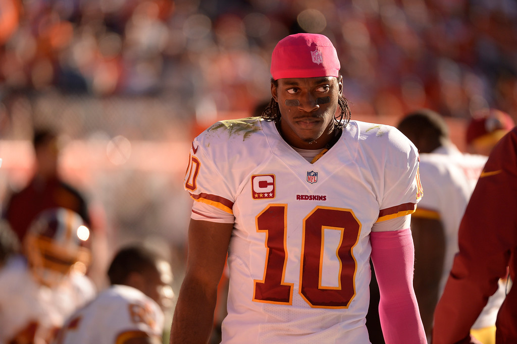 . DENVER, CO - OCTOBER 27: Washington Redskins quarterback Robert Griffin III (10) watches from the sidelines in the second quarter. The Denver Broncos take on the Washington Redskins at Sports Authority Field at Mile High in Denver on October 27, 2013. (Photo by John Leyba/The Denver Post)