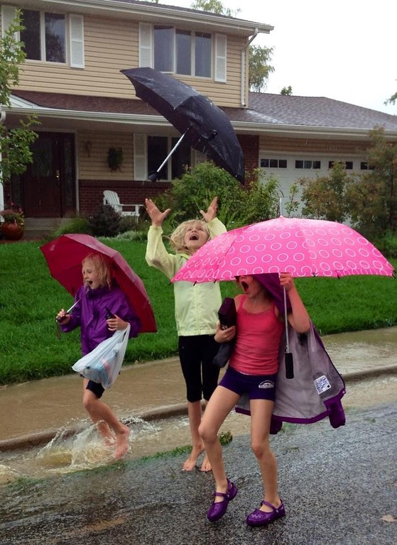 . Three friends finding some joy in all of this rain. Photo by Heather Gottlieb