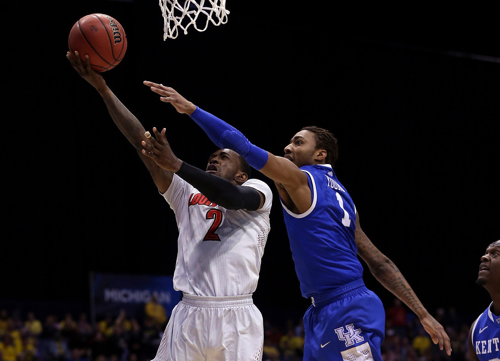. Russ Smith #2 of the Louisville Cardinals drives to the basket against James Young #1 of the Kentucky Wildcats in the first half during the regional semifinal of the 2014 NCAA Men\'s Basketball Tournament at Lucas Oil Stadium on March 28, 2014 in Indianapolis, Indiana.  (Photo by Jonathan Daniel/Getty Images)