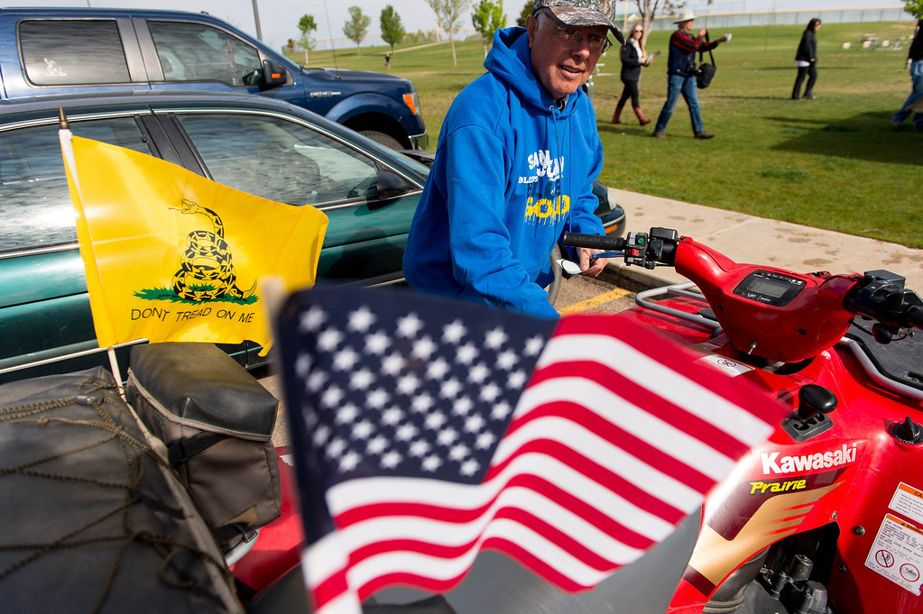 . Robert Bowing attached flags to his ATV in Blanding\'s Centennial Park Saturday May 10, 2014, prior to an ATV ride into Recapture Canyon, closed to motorized use since 2007 to protect the seven-mile long canyon\'s archeological sites. (Photo by Trent Nelson/The Salt Lake Tribune)