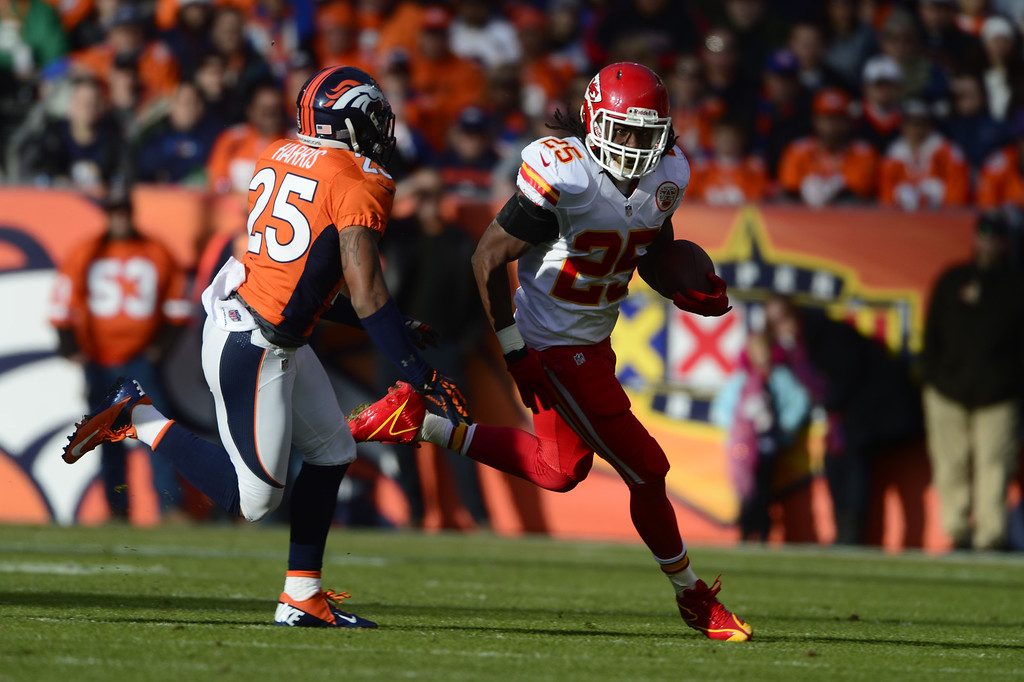 . Kansas City Chiefs running back Jamaal Charles (25) makes a run in the second quarter as Denver Broncos cornerback Chris Harris (25) tries to make a tackle as the Denver Broncos took on the Kansas City Chiefs at Sports Authority Field at Mile High in Denver, Colorado on December 30, 2012. AAron Ontiveroz, The Denver Post