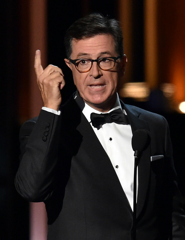 . TV personality Stephen Colbert speaks onstage at the 66th Annual Primetime Emmy Awards held at Nokia Theatre L.A. Live on August 25, 2014 in Los Angeles, California.  (Photo by Kevin Winter/Getty Images)