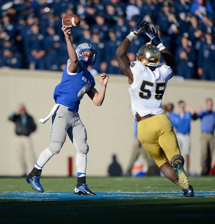. COLORADO SPRINGS, CO - OCTOBER 26: Air Force QB, Nate Romine, left, throws against the rush of Notre Dame OLB, Prince Shembo, at Falcon Stadium Saturday afternoon, October 26, 2013. (Photo By Andy Cross/The Denver Post)