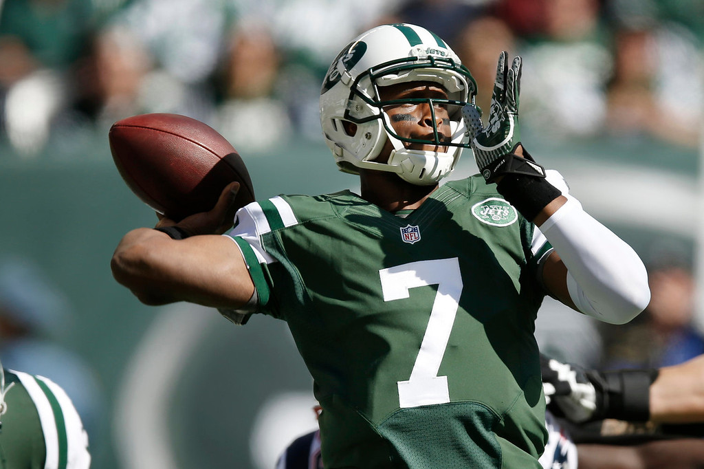 . New York Jets quarterback Geno Smith (7) throws a pass during the first half of an NFL football game against the New England Patriots Sunday, Oct. 20, 2013, in East Rutherford.  (AP Photo/Kathy Willens)