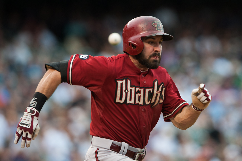 . Adam Eaton #6 of the Arizona Diamondbacks hustles to first base but is thrown out in the sixth inning of a game against the Colorado Rockies at Coors Field on September 22, 2013 in Denver, Colorado.  (Photo by Dustin Bradford/Getty Images)